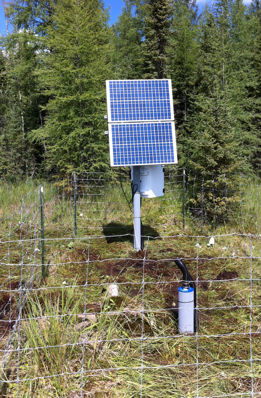 Solar panel and seismic station in TransAlta induced seismicity monitoring network